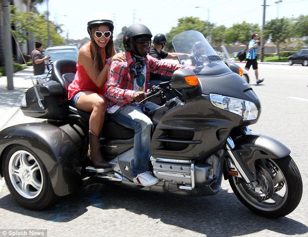 Picking up passengers: Sean Wright-Phillips was seen with a girl on the back of his bike