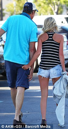 Let's go home: Hayley goes to grab her man's bottom as they make their way to their car