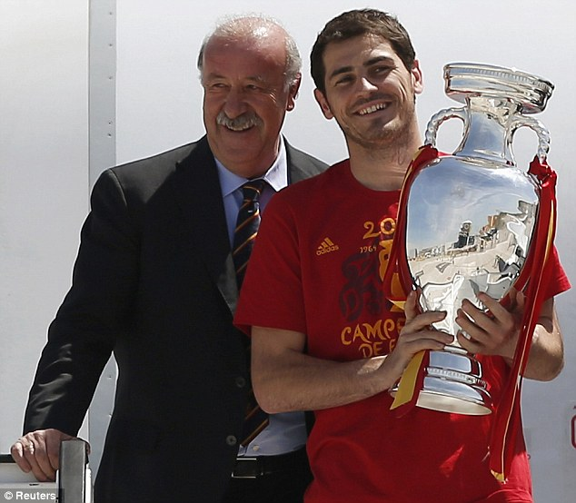 All smiles: Del Bosque and Casillas enjoyed touching down in Madrid