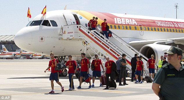 Landing: The Spanish side wore shorts and t-shirts as they emerged into the Madrid heat