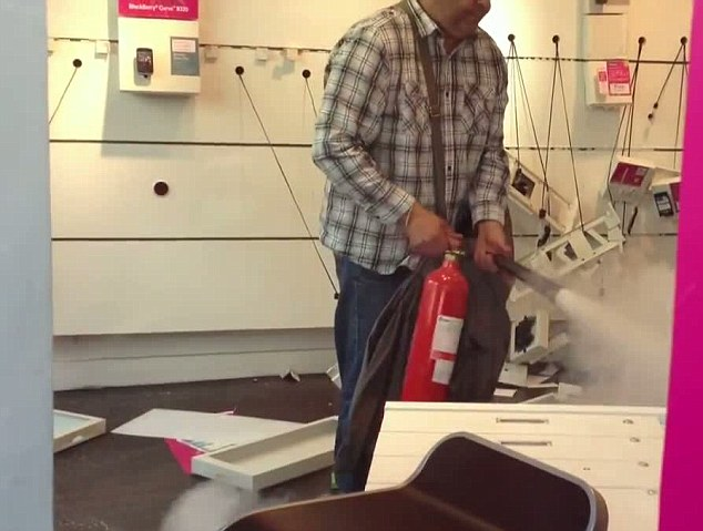 Angry: He then proceeds to blast equipment with the fire extinguisher