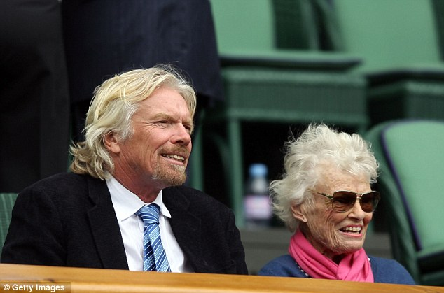 Sir Richard Branson, left, and his mother Eve Branson look on from the Royal Box on Centre Court which has a roof to protect it from the rain