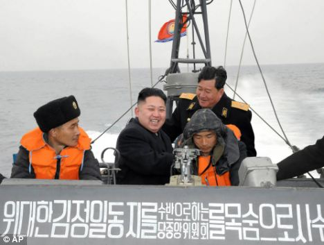 Kim Jong Un, pictured here second left riding a boat, is trying to portray himself as a more fun-loving leader