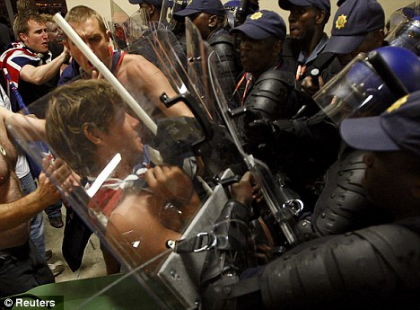 Strength in numbers: South African police fend off New Zealand fans in Polokwane