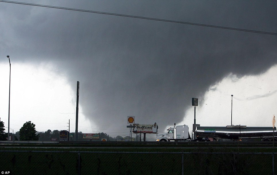 Deadly Nature: A tornado moves through Tuscaloosa, Alabama, in April last year, in a storm that cost more than a dozen lives