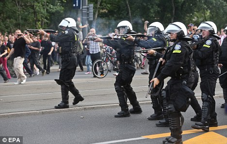Flaring up: Police intervene as Polish and Russian fans clash in Warsaw