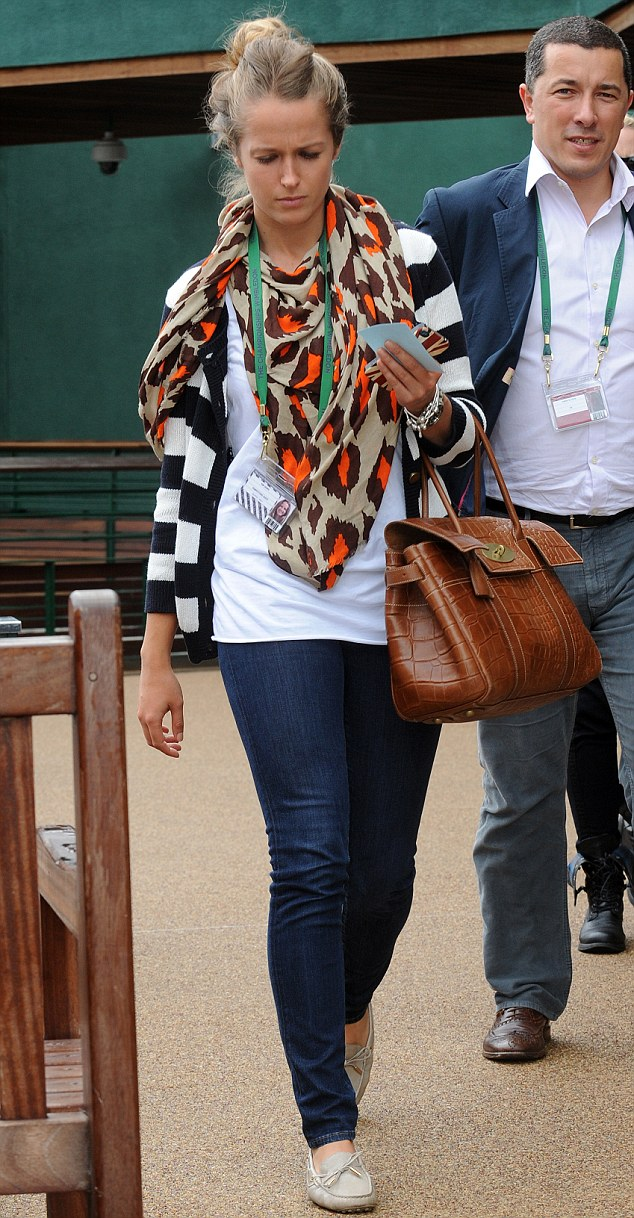 Simple yet stylish: Kim didn't let the rain at Wimbledon bother her today