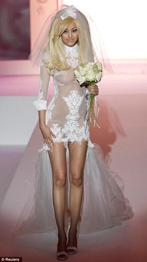 Couture Barbie: Former courtesan Zahia Dehar presented her autumn/winter lingerie line during Paris couture week last night