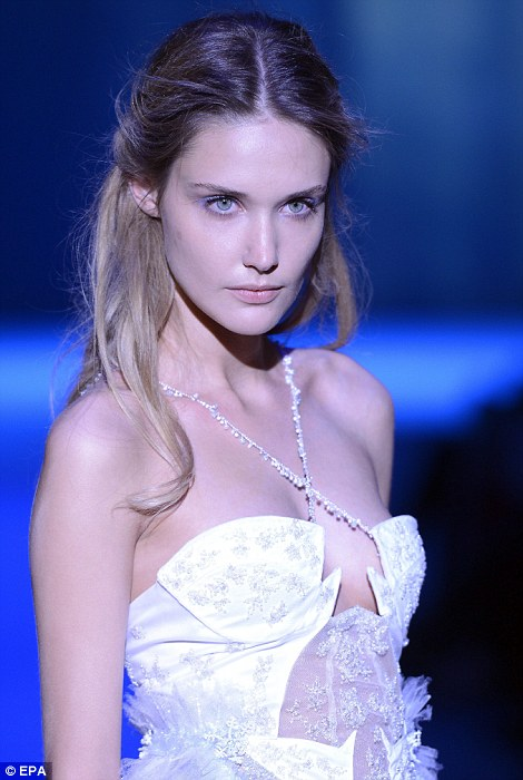 Romantic: A beaded white corset was trimmed with frothy lace