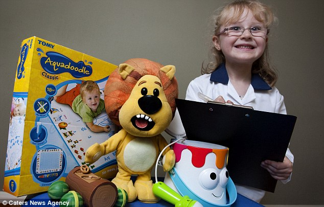 Best job in the world: Five-year-old Jessica Rosbrook is an official toy tester for Tomy and has scores of products delivered to her house every day