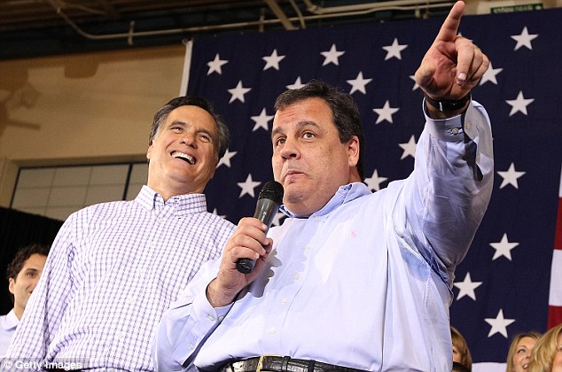 Republican presidential candidate Mitt Romney (L) looks on as New Jersey Governor Chris Christie (R) speaks during a rally at Exeter High School on January 8, 2012 in Exeter, New Hampshire