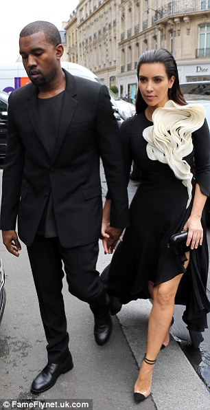 Making a statement: Despite mixing with the fashionistas, Kim's dress ended up dwarfing her petite frame