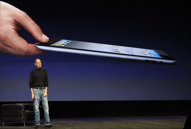 Cashing in: The fortunes of Microsoft are in stark contrast to those of Apple, which under Steve Jobs (pictured) took a leap of faith with touchscreen products such as the iPad (above) and now makes more money than all of Gates' products combined