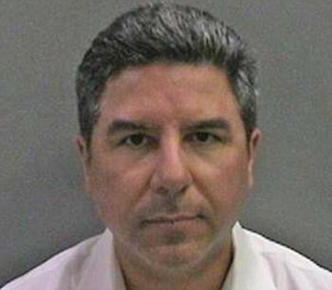Position of power: Carlos Bustamante, 47, has been charged with sexual assault after he allegedly groped female employees in his office in Orange County, California