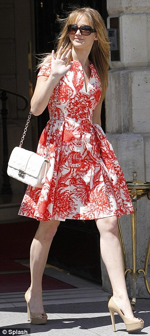 Feminine lady: Lawrence wore a striking red and white dress and also a bright purple one to attend two different Dior events