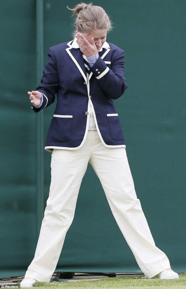 The line judge was applauded by the crowd when she left the court after being hit with the ball travellling at 118mph