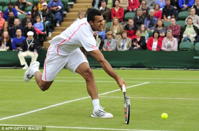 The Frenchman plays a forehand shot during his fourth round men's singles match