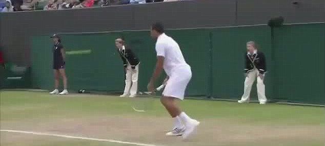 A powerful serve by Mardy Fish heads towards a line judge as his opponent Jo-Wilfried Tsonga watches