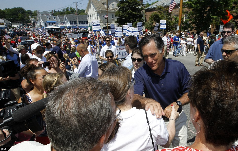 Meet and greet: The former Massachusetts governor is seen walking in the Fourth of July Parade  in Wolfeboro, shaking hands with parade attendees