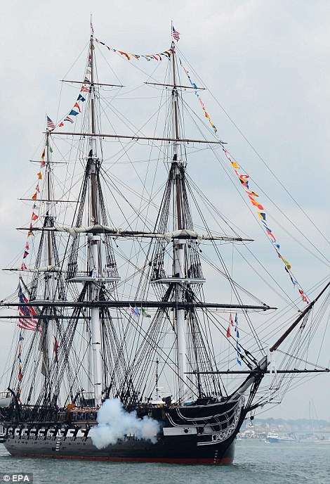 The USS Constitution fires its cannons during the annual turn around in Boston Harbor
