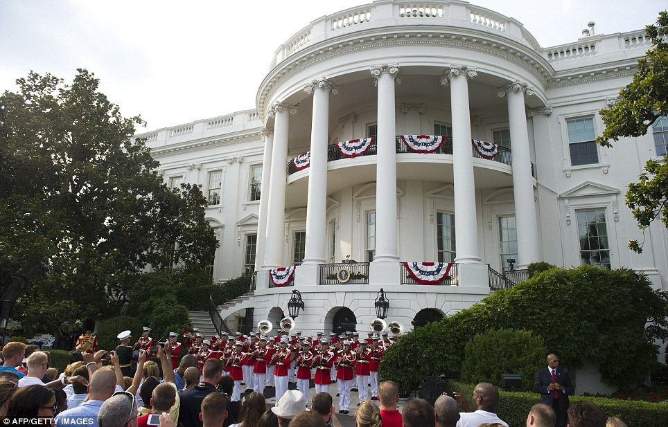 Pomp and circumstance: Guests at the Independence Day celebration for military members, their families and members of the administration were treated to several performances by a brass band
