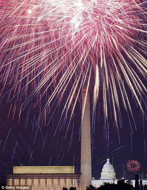 Patriotic: Fireworks light up the sky over the Lincoln Memorial, Washington Monument, and the U.S. Capitol