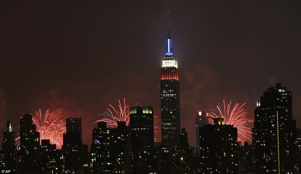 New York state of mind: The fireworks display, as seen from Queens, can be seen over the top of the buildings