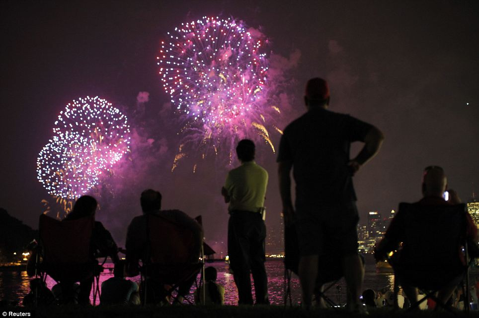 Jersey shore: People look at fireworks exploding over the Hudson River and the skyline of New York during the Independence Day celebration as seen from Hoboken, New Jersey