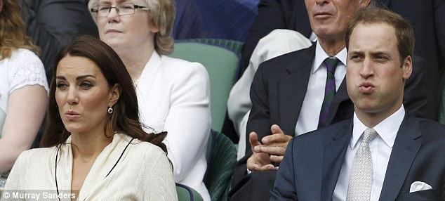 Gripped: William and Kate are on the edge of their seats as they watch Andy Murray and David Ferrer battle it out