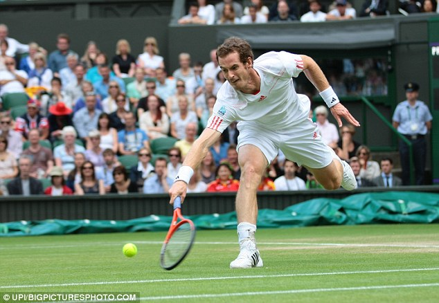 Stretching out: Murray struggles to scoop the ball back to Ferrer