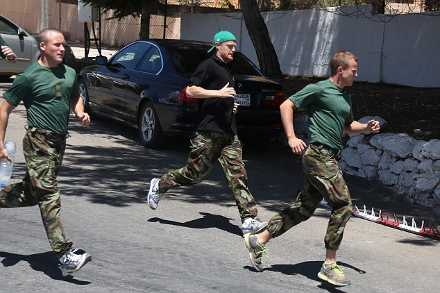 No stopping! The endurance test included a 3km run and pushing an armoured van up a hill (below)