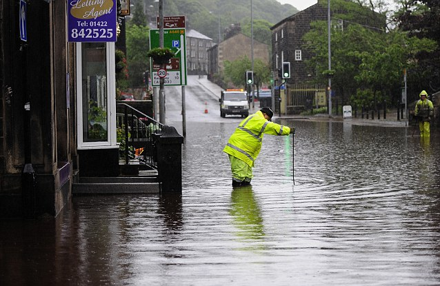 Washout: The Environment Agency has urged communities in the north and east of England, the Midlands and much of Wales to be prepared for flooding as two bands of heavy rain are set to cross the UK tomorrow and Saturday