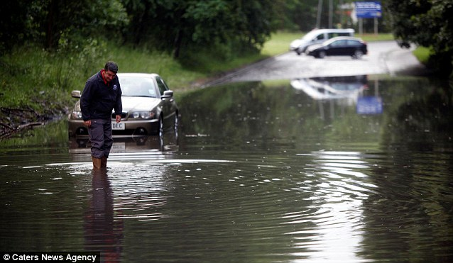 Waterworld: Heavy rain has already hit Scotland where three foot high flooding meant firefighters in Glasgow have been forced to rescue motorists stranded in their cars