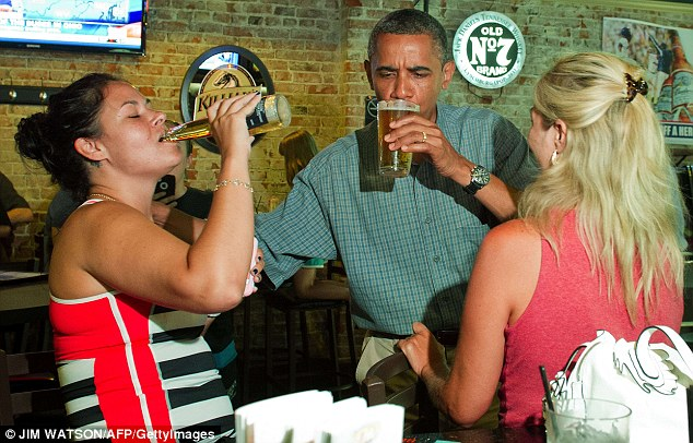 Refreshment stop: President Obama stopped for a drink in Ohio with patrons Suzanne Woods and Jennifer Klanac during an unannounced visit