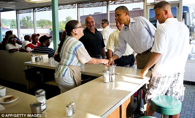 Bad news: The figures are a blow for President Obama's re-election campaign. He was touring Ohio today, where he met customers at restaurant Ann's Place in Akron, above