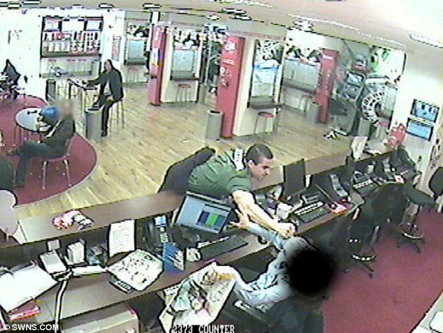 The attack happened in a branch of Ladbrokes, on Southgate Street in Gloucester