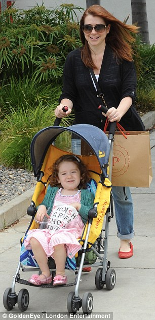Burning the baby weight: New mother-of-two Alyson Hannigan looked fantastic as she pushed three-year-old Saytana through their Brentwood neighbourhood today