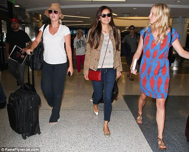 Chummy: The Vampire Diaries co-stars Sara Canning, Nina Dobrev and Candice Accola walk through Los Angeles International Airport on Friday