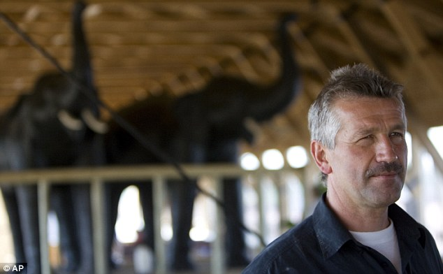 Ambition: Mr Huibers stands in front of two model elephants on his first ship in 2007