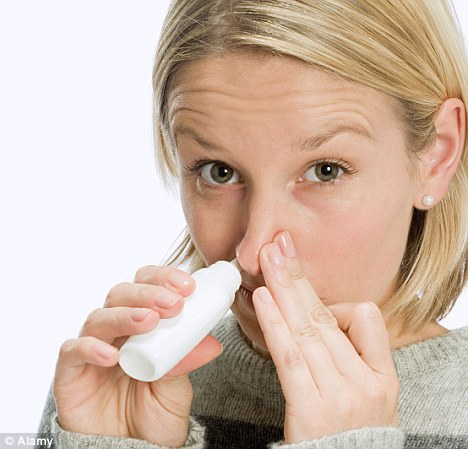 Super spray: A new drug, delivered through a nasal spray, can fight off flu in just two hours (posed by model)