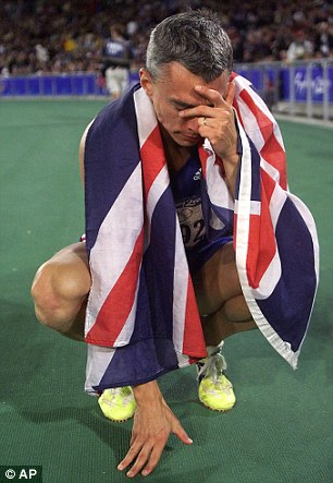 Great Brit: Jonathan Edwards draped in the Union Jack after he won the gold medal in the men's triple jump 2000 Sydney Olympics