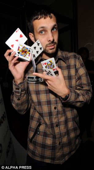 Steven Frayne a.k.a. Dynamo does a card trick at the Mayfair Hotel in London