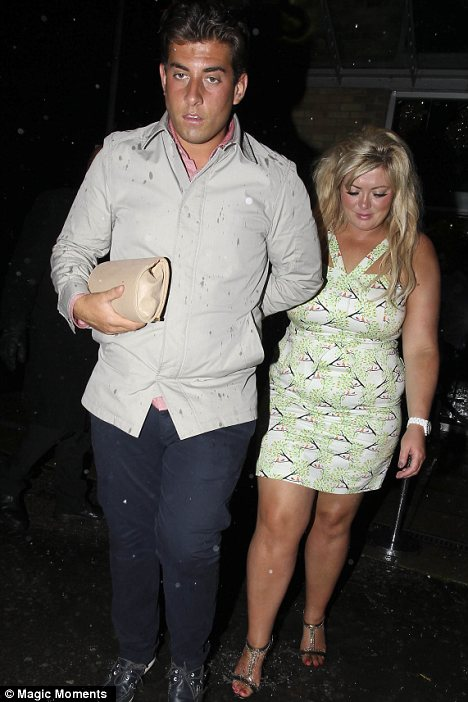 What a gent: Arg was seen carrying his girlfriend's bag for her