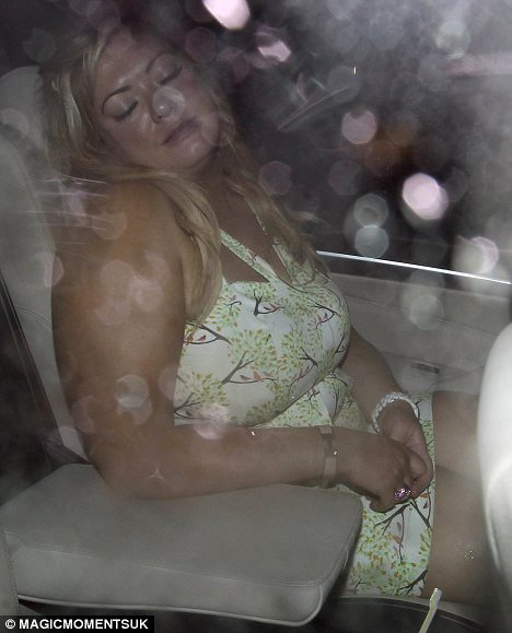 Ready for bed: The plus-sized fashion designer and reality star fell asleep as soon as she got into the back of the taxi on the way home from a night out at Faces