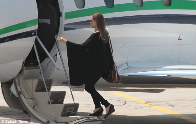 Fashion follower: The actor looked superb in the outfit and was as gracious as ever as she boarded the private jet