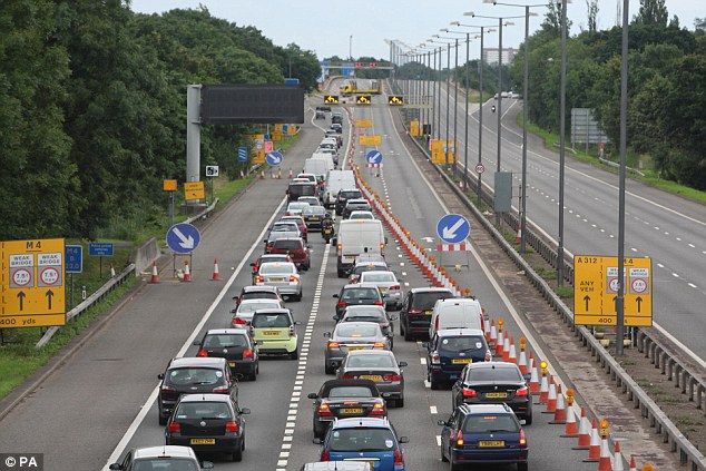 Jam: Traffic filters off the M4 approaching the closed section yesterday. The motorway is not expected to re-open until Thursday at the earliest
