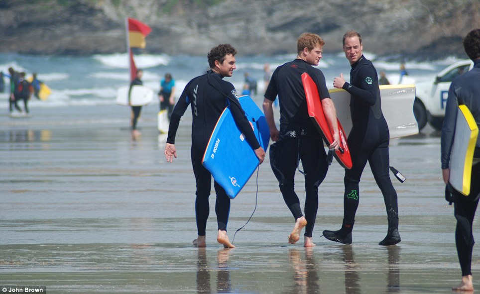 Surf's up: Prince Harry joined his brother to body board with friends at a beach in Cornwall