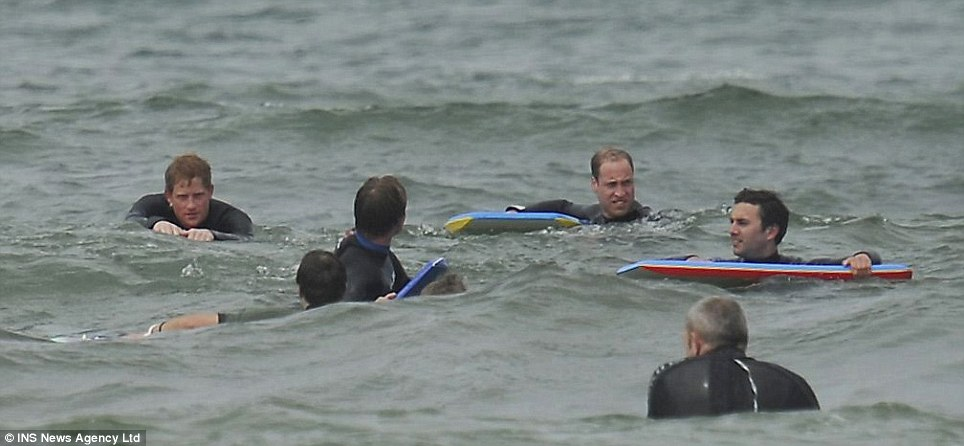 Water sports: Prince William chose to spend the day at the beach with his brother while his wife Kate enjoyed the tennis
