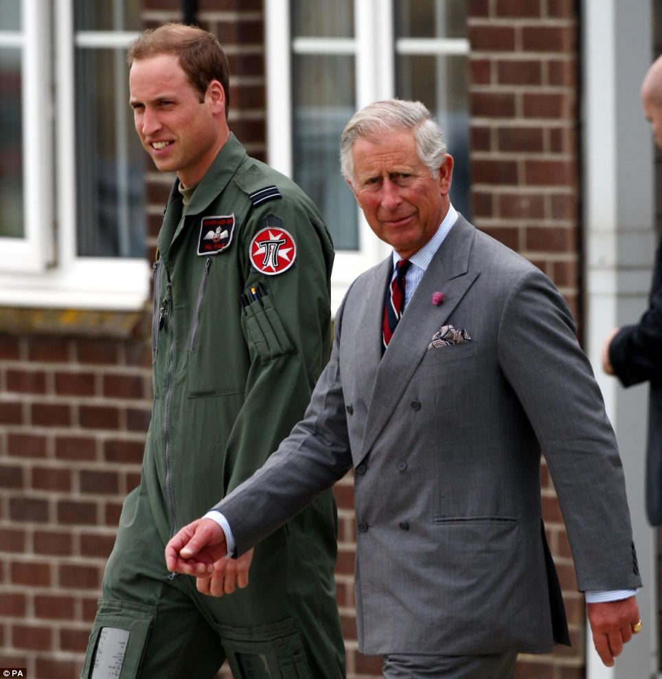 Father and son: Prince William showed Prince Charles around the RAF Valley on Anglesey