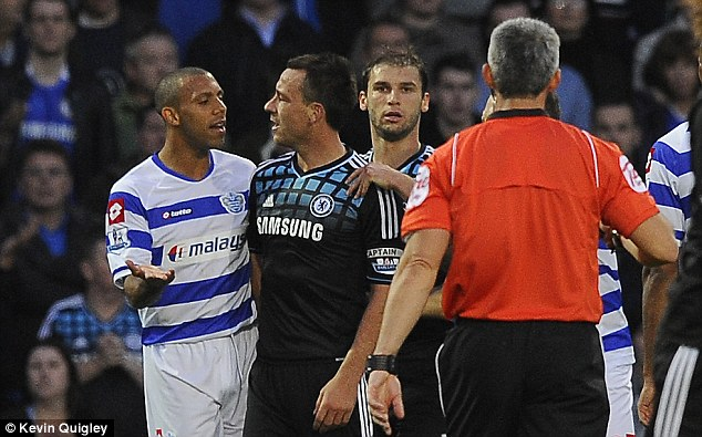 Accused: Terry denies any wrongdoing after being charged with shouting an offensive comment to Ferdinand
